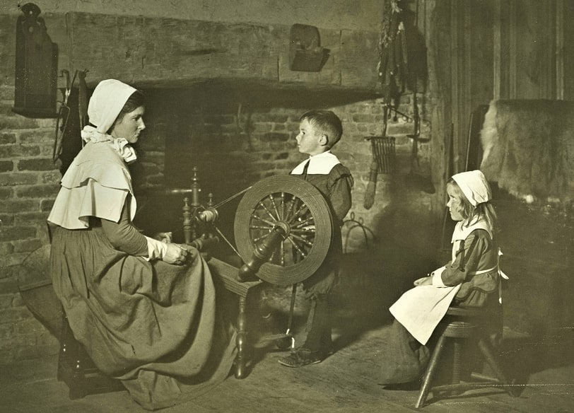 Photo: Mrs. Mercie Hatch Barnes instructs son Souther and daughter Mercie on yarn making, Plymouth Plantation style, c. 1940. Courtesy of Plymouth Antiquarian Society Archives, Plymouth, Massachusetts.