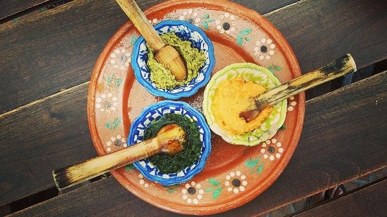 Photo: (clockwise from top) habanero, chipotle and chimichurri salsas